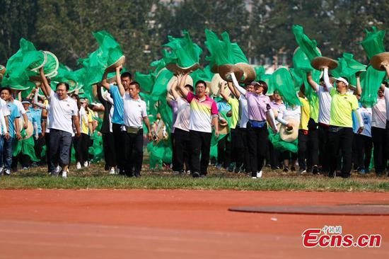 Students, teachers and farmers train for PRC's 70th anniversary celebrations